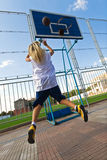 Girl playing basketball outside. Young blond girl is playing basketball outside Royalty Free Stock Photo
