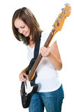 Girl playing bass guitar isolated on white Royalty Free Stock Photography