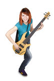 Girl playing bass guitar and smiling. Young beauty redhead girl playing bass guitar and smiling, full body, isolated stock photos