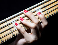 Girl playing bass. A girl playing bass 5 string Stock Images