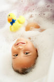 Girl Playing In Bath Stock Images