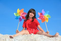 Girl playing on beach Stock Images