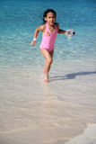 Girl Playing At Beach Stock Images