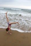 Girl Playing at Beach royalty free stock image