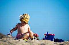 Girl playing on  beach Stock Photography