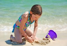 Girl Playing on Beach Royalty Free Stock Images