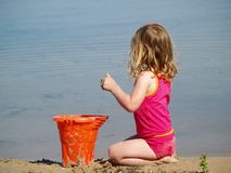 Girl playing at beach Stock Photo