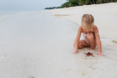 Girl playing on a beach Royalty Free Stock Photo