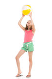 Girl playing beach ball. Girl in pink shirt and green shorts is playing beach ball. Full length studio shot isolated on white Royalty Free Stock Photos