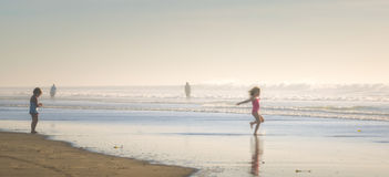 Girl Playing at the Beach, California Stock Photos