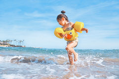 Girl Playing on Beach during Daytime Stock Photo