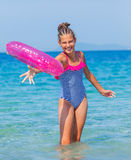 Girl playing on the beach Stock Photography