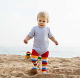 Girl playing on the beach Stock Images