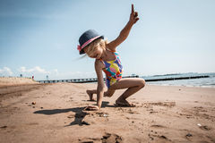 Girl playing on the beach Royalty Free Stock Photos