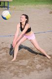 Girl playing beach volleyball Royalty Free Stock Photo