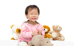 Girl playing with bear and hippo toy Royalty Free Stock Image