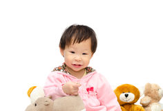 Girl playing with bear and hippo toy Royalty Free Stock Photos
