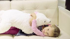Girl playing with a bear stock video footage