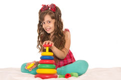 Girl playing  on bed Stock Photography