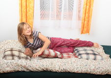 Girl playing on bed Royalty Free Stock Photo