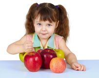 Girl playing with big ripe apples Stock Images