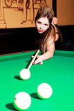 Girl playing billiard Stock Photography