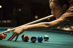 Girl playing billiard. Girl preparing to play some balls in billiard game stock photos
