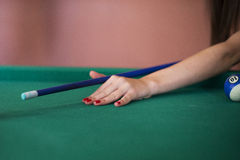 Girl playing billiard Royalty Free Stock Images