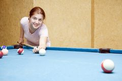 Girl playing billiards Stock Photo