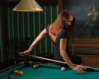 Girl playing billiards Royalty Free Stock Photos