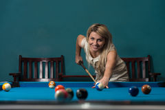 Girl Playing Billiards Stock Image