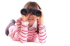 Girl playing with binoculars Royalty Free Stock Photo