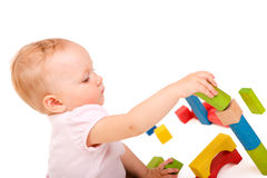 Girl playing with blocks Stock Photography