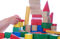 Girl playing with blocks royalty free stock images