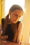 Girl playing a board game. In school royalty free stock image