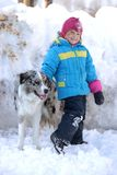 Girl playing with a Border Collie. In nature Royalty Free Stock Photo