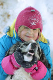 Girl playing with a Border Collie. In nature Stock Photo