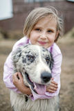 Girl playing with a Border Collie Stock Image