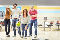Girl playing bowling Stock Photos
