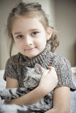 Girl playing with a british cat Royalty Free Stock Image