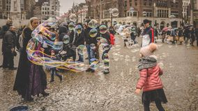 Girl Playing with bubbles in Amsterdam stock photography