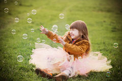 girl is playing with bubbles in a park Royalty Free Stock Images