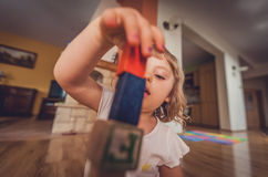 Girl playing with building blocks on floor Royalty Free Stock Photo