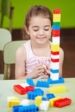 Girl playing with building blocks Royalty Free Stock Images