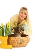 Girl playing with bunny Stock Photos