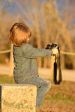 Girl playing with camera. Young girl making faces at camera Stock Photography