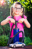 Girl playing with a car  - adding air pressure - pumping air int Royalty Free Stock Images