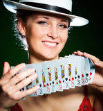 Girl and playing cards Royalty Free Stock Photos