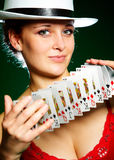 Girl and playing cards Royalty Free Stock Image