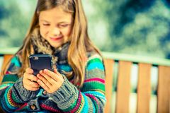 Girl Playing Cell Phone Royalty Free Stock Images